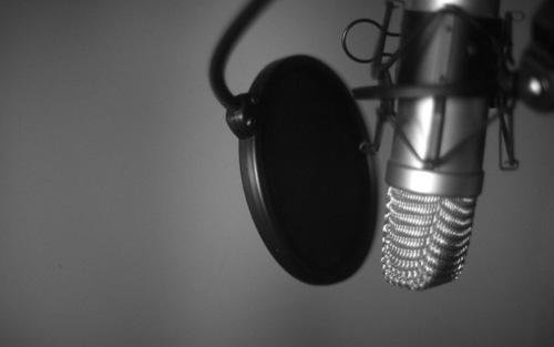 Lovepik_com-100401695-looking-at-a-singers-mic.jpg