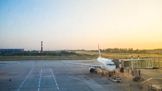Lovepik_com-500617171-sunrise-airport_.jpg