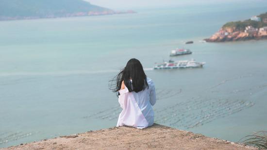 Lovepik_com-500658359-dongji-island-tourism-female-figure_.jpg
